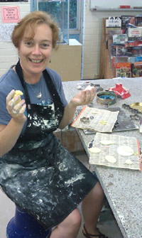 Belinda Stinson working on her new jewellery designs at the pottery studio at UNSW