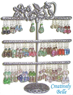 With 60 holes the three tier earring holder can carry a pair of earrings per hole. Earrings can also hang over the decoration. This earring holder is great for carrying heaps of earrings. Earring stands make great gift ideas too!